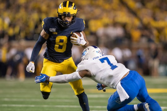 Receiver Ronnie Bell (8) and Michigan remain No. 7 in this week's Associated Press Top 25.