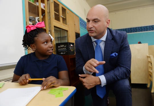 Dr. Nikolai Vitti, right, talks to Madison Marshall, 8, about her class work and first day of school. Dr. Nikolai Vitti, Superintendent of Detroit Public Schools visits the students at Edmonson Elementary school on September 3, 2019, Detroit, Mi.