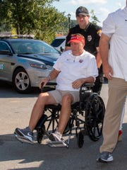 Liberty football coach Hugh Freeze arrived to coach from a wheelchair this past weekend.