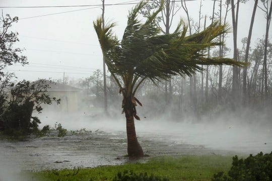 A road is flooded during the passing of Hurricane Dorian in Freeport, Grand Bahama, Bahamas, Monday, Sept. 2, 2019. Hurricane Dorian hovered over the Bahamas on Monday, pummeling the islands with a fearsome Category 4 assault that forced even rescue crews to take shelter until the onslaught passes.