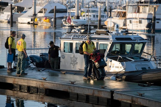 Divers with the San Luis Obispo County Sheriff's Dive Team prepare to search for missing people following a dive boat fire off Southern California's coast that killed dozens sleeping below deck, on Tuesday, Sept. 3, 2019, in Santa Barbara, Calif.