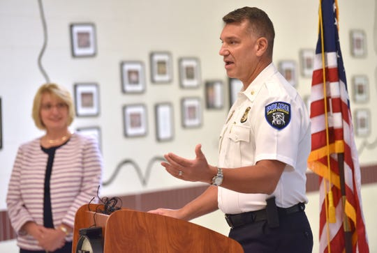 Shelby Township Deputy Police Chief Mark Coil addresses the media as Utica Community School District Superintendent Christine Johns listens.