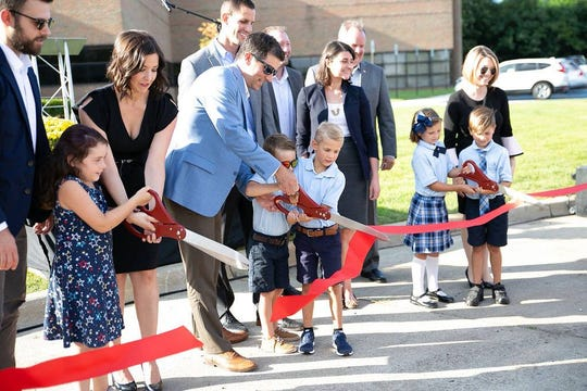 Tyler Horning, center, at Ivywood Classical Academy's ribbon cutting on Aug. 22.