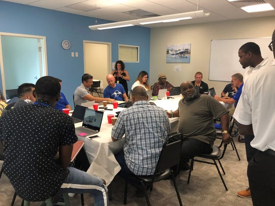 Officials at Tropic Ocean Airways in Fort Lauderdale work on plans for getting supplies to the Bahamas after Hurricane Dorian devastated the island nation.