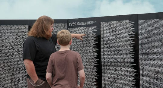 The Vietnam Traveling Memorial Wall is a three-fifths-scale replica of the real memorial in Washington, D.C. The approximately 300-foot-long wall features the names of more than 58,000 U.S. soldiers who died or went missing during the Vietnam War.