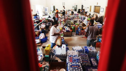 Members of the Christ Episcopal Church in the Coconut Grove neighborhood of Miami, Florida take in and sort donated supplies, Tuesday, September,3, 2019 that will eventually make its way to the Hurricane Dorian stricken Bahamas. The small island chain was devastated by the Category 5 storm. The hope is that the supplies will be flown over via sea plane once life saving support subsides.