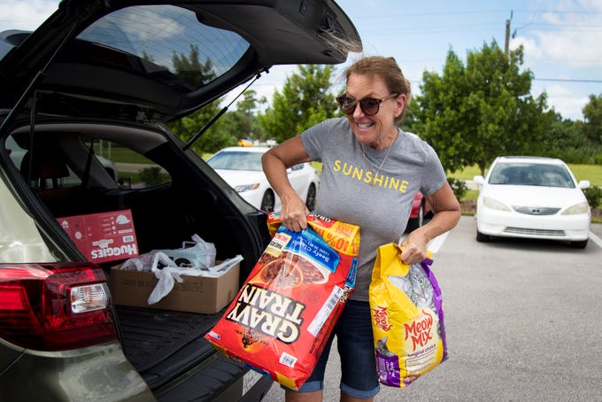 Janice Heligman of Fort Myers drops off pet food along with other donations for people in the Bahamas at Stokes Marine on Tuesday, September 3, 2019, in south Fort Myers. ÒIÕve been through many hurricanes, and I think that if the shoe was on the other foot, IÕd want help. We gotta help each other,Ó Heligman said.