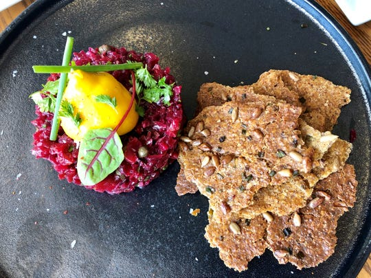 Harvest & Wisdom finishes its beet and carrot tartare ($12) with a sunny dollop of mango puree. The dish is a brilliant vegan riff on steak tartare.