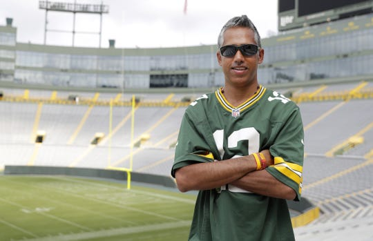 Jaz Singh, a Green Bay Packers fan on sabbatical from his teaching position in Australia, plans to attend all of the Packers and Wisconsin Badgers football home and road games during the season.