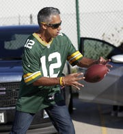 Jaz Singh, a Green Bay Packers fan on sabbatical from his teaching position in Australia, plays catch while tailgating before the Packers' preseason game against the Kansas City Chiefs on Aug. 29, 2019 in Green Bay, Wis. Sarah Kloepping/USA TODAY NETWORK-Wisconsin