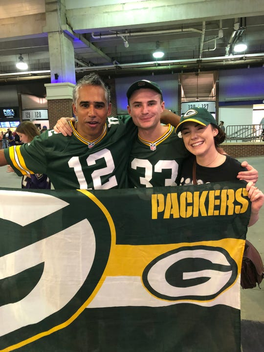 Jaz Singh, an Australian teacher who plans to attend all Green Bay Packers games in 2019, poses with fellow Packers fans in Baltimore before the preseason game on Aug. 15, 2019.