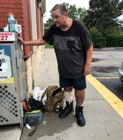 Bradley Matteson, who identifies himself as homeless, talks about hunkering down incoming Hurricane Dorian, as he charges his cell phone at a gas station on S.C. highway 17 in Myrtle Beach, South Carolina Monday, November 2, 2019.  Many are preparing for Hurricane Dorian to arrive Wednesday evening along the South Carolina coast.