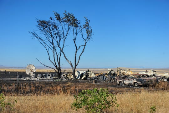 Charred property on Golden Valley Loop burned in Monday afternoon's grass fire northwest of Great Falls.