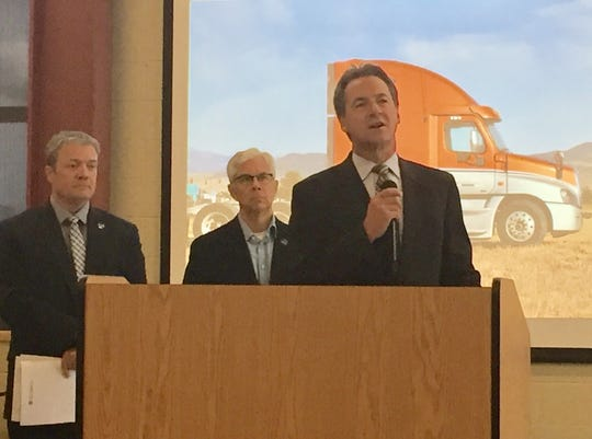 Gov. Steve Bullock talks Tuesday about the state's Labor Day Report at the Helena College's airport campus. With him are Lt. Mike Cooney, center, and Department of Labor & Industry Director Galen Hollenbaugh.