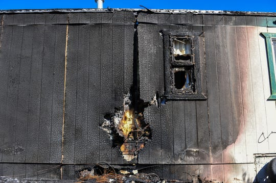 The McIlwain residence at 67 Golden Valley Loop suffered fire damage on one side of the home in Monday afternoon's grass fire on the northwest side of Great Falls.