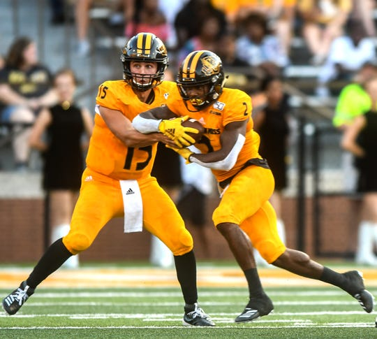 Golden Eagles quarterback Jack Abraham (15) fakes a handoff to wide receiver Jaylond Adams (2) during the second quarter against Alcorn State Aug. 31, 2019.
