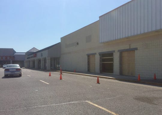 An entry way and windows have been cut into the exterior wall at the former Kmart in Gardenside Shopping Center. A portion of the former Kmart will soon hold a Mighty Dollar store.