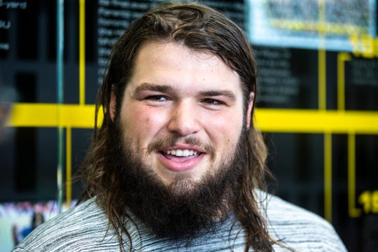 Iowa offensive lineman Kyler Schott talks with reporters during a football player media availability, Tuesday, Sept. 3, 2019, at the Hansen Football Performance Center in Iowa City, Iowa.