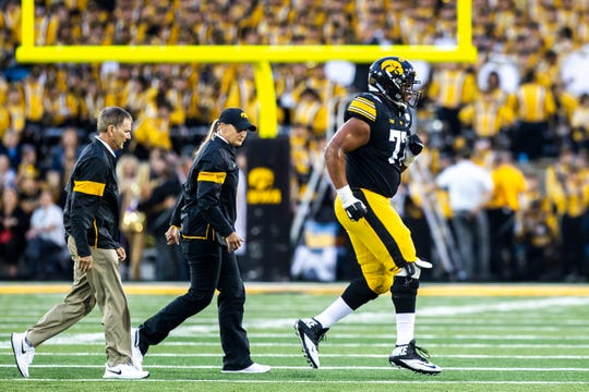 Iowa offensive lineman Alaric Jackson (77) jogs off the field to the sideline during a NCAA non conference football game, Saturday, Aug. 31, 2019, at Kinnick Stadium in Iowa City, Iowa.