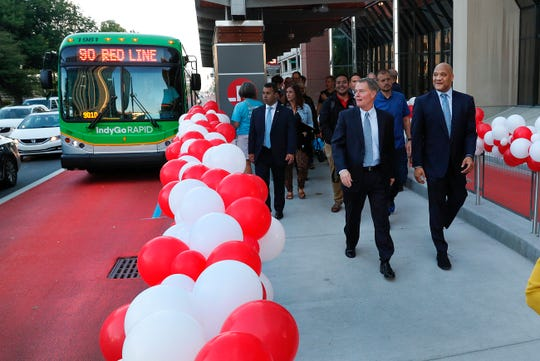 Indianapolis Mayor Joe Hogsett and Indiana Congressman Andre Carson, right, exit a Red Line bus on their way to the opening celebration on Tuesday, Sept. 3, 2019.