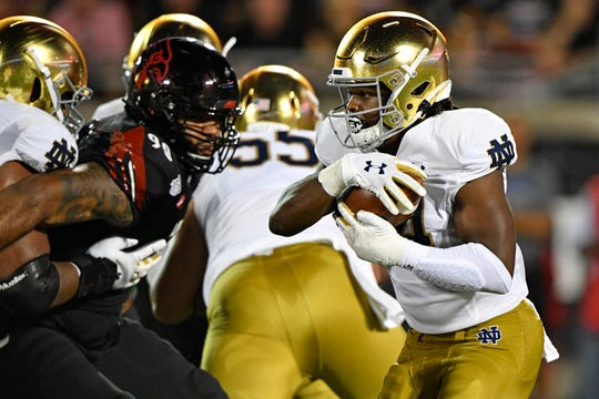 After sloppy first half, Notre Dame opens season with 35-17 win over Louisville