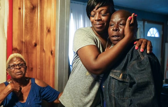 Starice Bailey,left, looks on as Antonia Bailey and Casita Moore embrace at Starice's home in Indianapolis on Wednesday, Aug. 28, 2019. Starice, Antonia and Casita are the great aunt, mother and grandmother, respectively, of the Nelson siblings, who were fatally shot near their home in Indianapolis on Aug. 23, 2019.