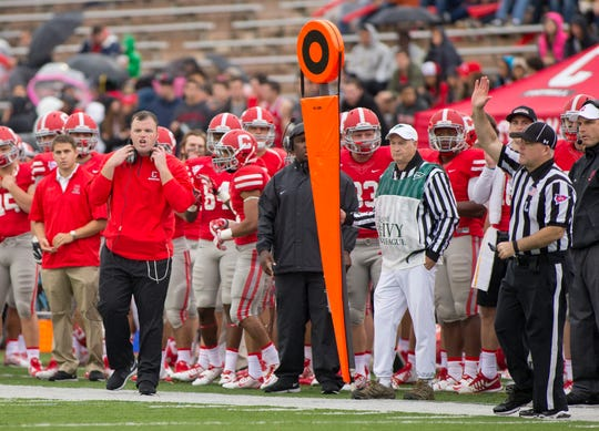 Cornell football coach David Archer gets his point across to his team during its game against Yale on Saturday, Oct. 4, 2014.