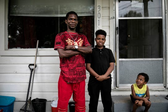"Joshua K. Love stands with his son, Joshua K. Love Jr., center, and his nephew, Mason Martinez, on the front porch of his home in Greenwood, Miss., Saturday, June 8, 2019. ""I tell my son I want him to be a better man than I am,"" the elder Love says. ""I don't want him living my broken dreams."""