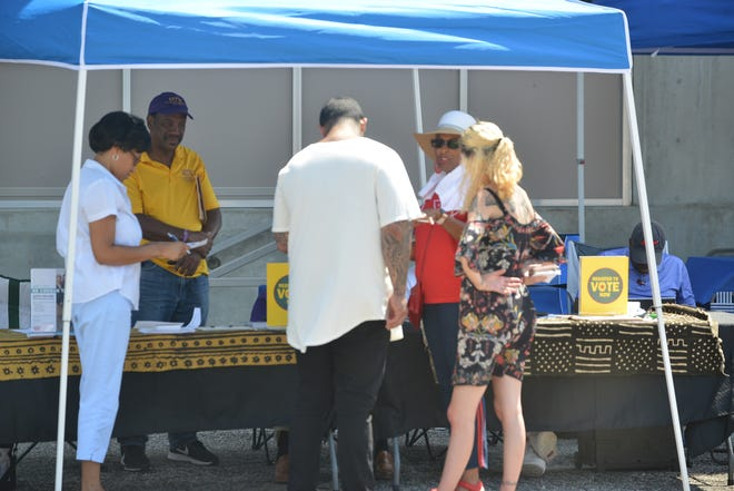 Robin Gadsden-Dupree, second from the right, talks to community members about registering to vote and the upcoming census. Gadsden-Dupree is part of United We Stand, a group of Divine 9 organizations that work together to make the community aware of the importance of voting and the census.