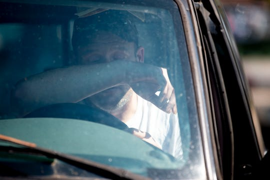 Larry Holloway becomes emotional in his truck as he waits for students to be released at Powell High School after unconfirmed reports of shots fired outside the school Tuesday, Sept. 3, 2019. Holloway has two students at Powell.
