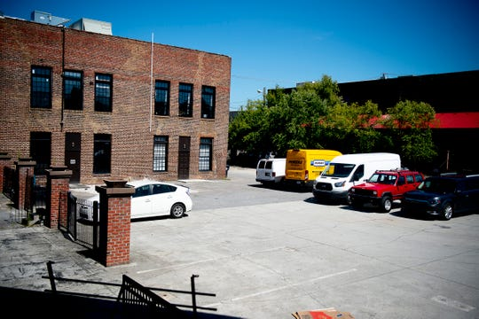 A section of parking lot will become the site of the future Stockyard Lofts building on Willow and Central Street in Knoxville, pictured here on Aug. 30.