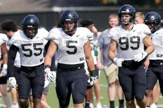 Purdue defensive end Derrick Barnes (55), Purdue defensive end George Karlaftis (5) and Purdue defensive lineman Jack Sullivan (99) walk onto the field during practice, Tuesday, Sept. 3, 2019 at the Bimel Practice Complex in West Lafayette.