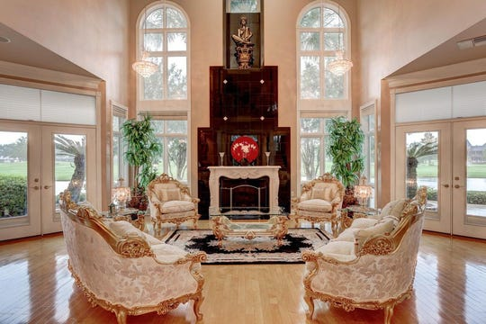 Broussard mansion with a columned music room, private balcony overlooking the 18th hole and gourmet kitchen is on the market for $988,000.