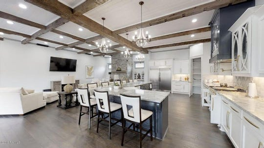 Lafayette mansion, on the market for $1,250,000, has two master bedrooms, an outdoor kitchen, and hand hewn cypress beams and engineered white oak and marble flooring throughout.
