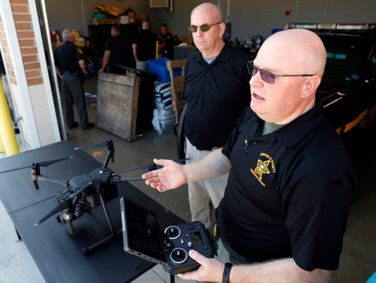 Fairfield Sheriff's Office Det. James Nicolia, right, and Auxiliary Deputy Dale O'Hare talk about the department's new drone program Friday, Aug. 30, 2019, at sheriff's office in Lancaster. Nicolia and O'Hare are two of pilots for the drone which the department plans to use for search and rescues and tracking suspects.