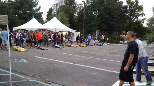 Charitable organization Men 4 A Cause host a cornhole tournament at Brighton's 2018 Smokin' Jazz & Barbecue Blues Festival. This year's festival will be held Friday and Saturday.
