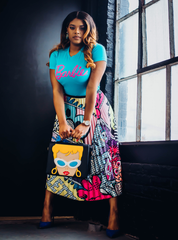 "From ""All is Fair in Love and Fashion"" online store, Haydee is wearing the Vintage Barbie Tee $35, Playful skirt $75, Vintage Barbie Purse $180"