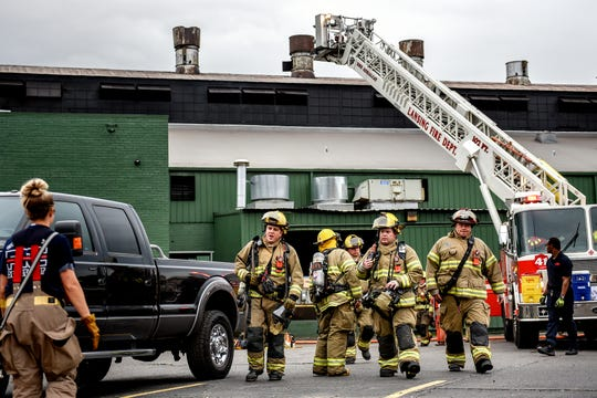 Firefighters work the scene of a fire that started at the Atmosphere Annealing plant on Tuesday, Sept. 3, 2019, in Lansing. No injuries were reported in the blaze.