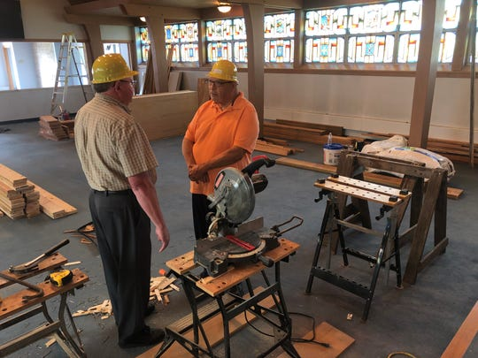 Discussing sanctuary expansion plans at Lakeshore Church in Manitowoc are members Allen Robinson, left, and Bill Pieczynski. During construction services are being held in its fellowship hall.