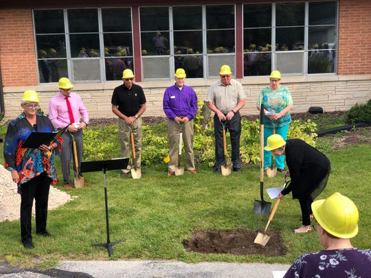 Lakeshore Church members celebrated a groundbreaking ceremony for an expansion-remodeling project now underway. Among the participants were, left to right, Rev. Carly Kuntz, Mark Hamann of Hamann Construction, and congregants Jim Pfefferkorn, Dave Bauman, Allen Robinson, Mary Drohman and Janet Garrett.