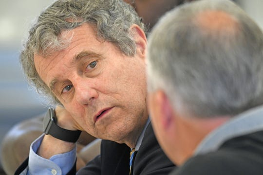 Senator Sherrod Brown listens to local labor leaders during a roundtable discussion atthe USW Local 169 hall on Tuesday.