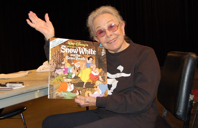"""Marge Champion, the model for Disney's original Snow White, poses in 2010 with the album cover for """"Snow White and the Seven Dwarfs."""""""