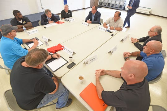 Senator Sherrod Brown listens to local labor leaders during a rountable atthe USW Local 169 hall on Tuesdayduring a roundtable discussion.