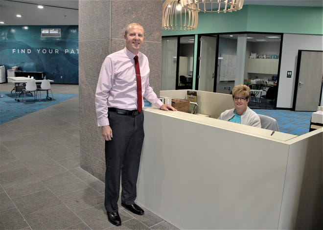 TRECA Digital Academy Executive Director Adam Clark, left, and receptionist Gina Benjamin are shown in the lobby of the online school's new office in downtown Marion. The building, which was the former home of several banks, is located at 107 N. Main St.