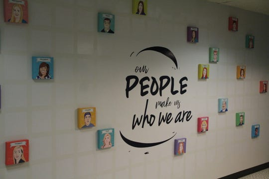 One wall of the employee lounge and lunchroom at TRECA Digital Academy's new Marion office is used to recognize employees for their accomplishments.