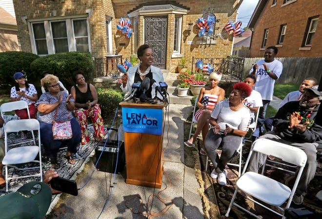 With supporters and friends at her side, state Sen. Lena Taylor announces her candidacy for Milwaukee mayor from her home.
