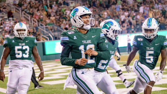 Tulane quarterback Justin McMillan (12) celebrates after scoring a touchdown against against Florida International on Thursday, Aug. 29, 2019 in New Orleans.