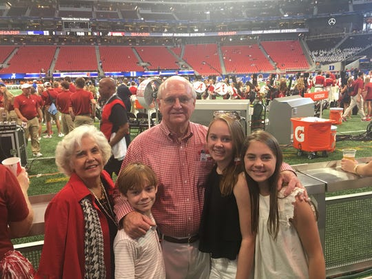 Mickey Griffin (center) attends Duke-Alabama game with his family.