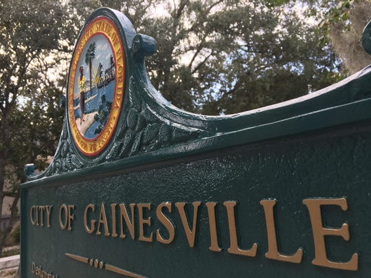 A historic marker stands outside City Hall in Gainesville, Fla. City officials said they're committed to an open email system.