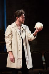 "Andy Rindlisbach in a scene from Alabama Shakespeare Festival's production of ""Hamlet,"" being presented by members of New York's Bedlam theater company. Four actors - Dria Brown, Edmund Lewis, Andy Rindlisbach and Mike Labbadia - play all the roles in productions of both ""Hamlet"" and ""Saint Joan"" at ASF."